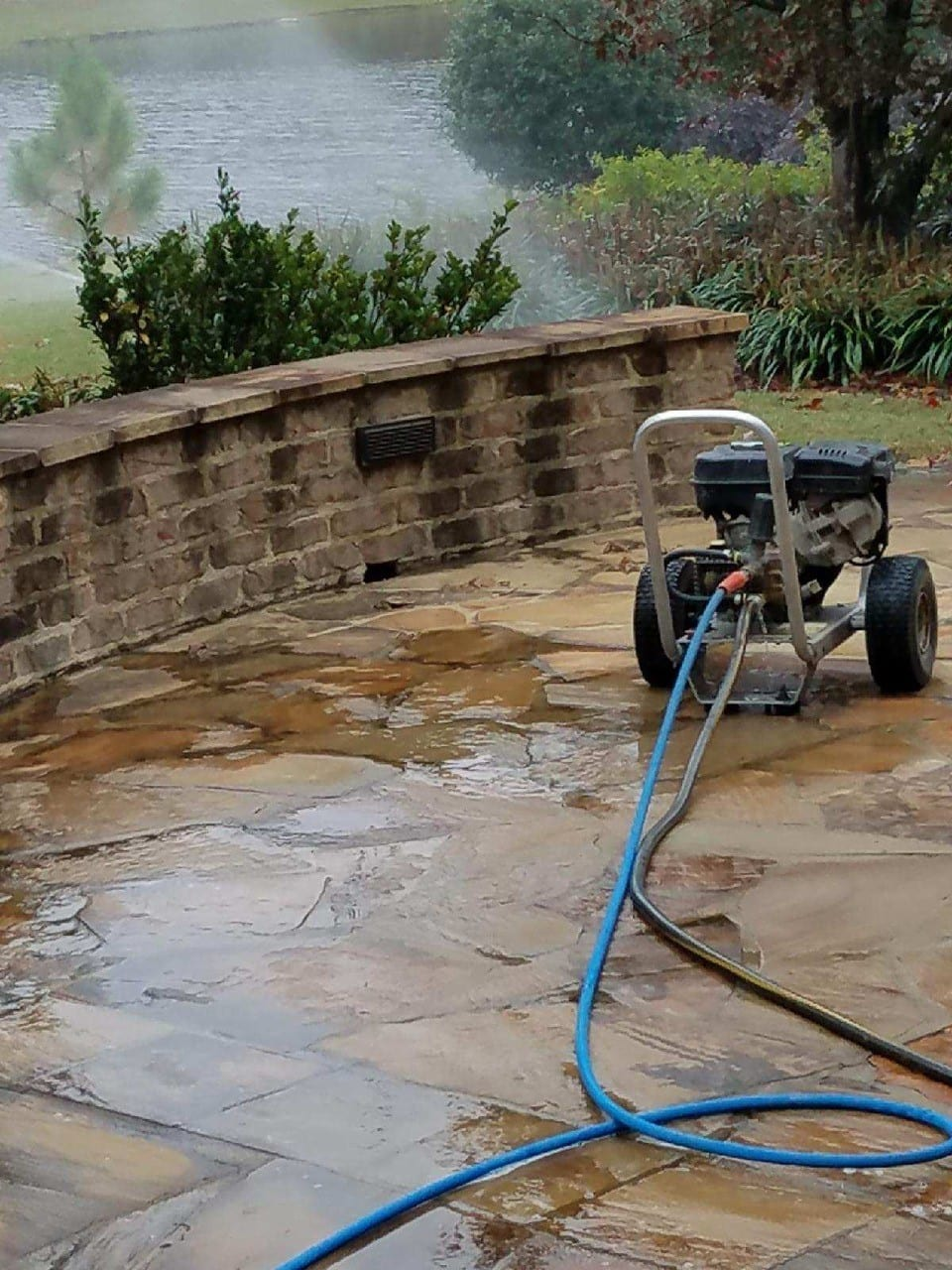 stone patio being pressure washed