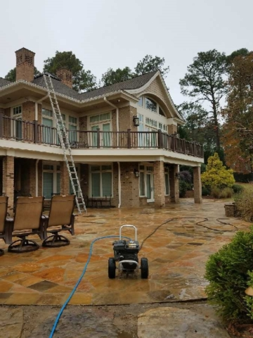 large view of stone patio being pressure washed