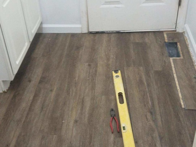 Photo of a floor in the process of being repaired